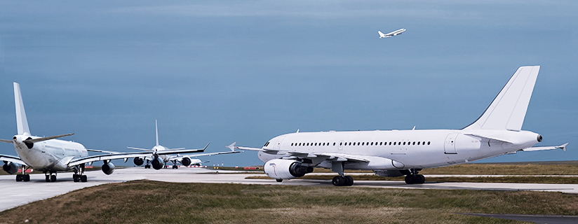 Airplanes lined up on runway.
