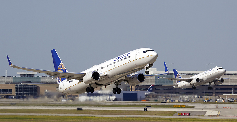 Two United Airlines airplanes taking off.