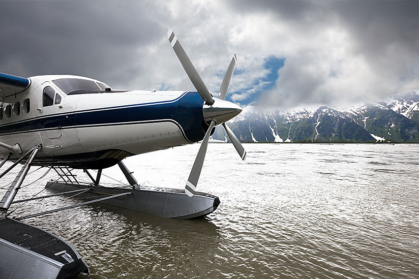 Float plane in front of mountains